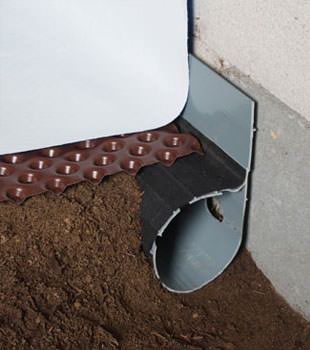Closeup of a crawl space drainage system installed in Ruckersville