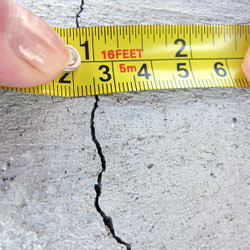 A crack in a poured concrete wall that's showing a normal crack during curing in Warrenton
