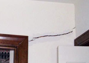 A large drywall crack in an interior wall in Danville