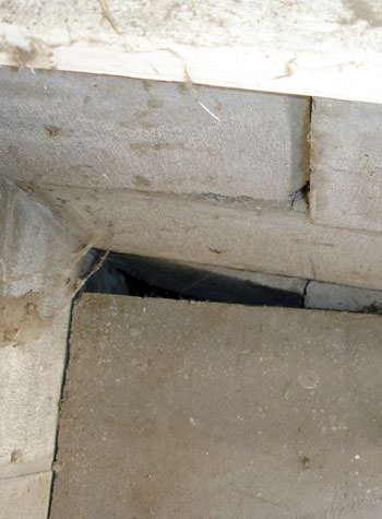 inward rotation of a foundation wall damaged by street creep in a garage in Locust Grove