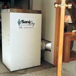 A basement dehumidifier with an ENERGY STAR® rating ducting dry air into a finished area of the basement  in Warrenton