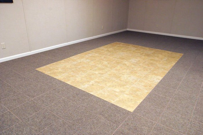 tiled and carpeted basement flooring installed in a Blacksburg home